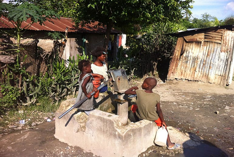 Haitian children at hand pump